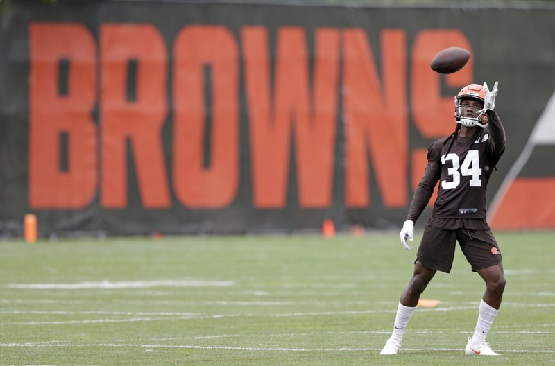 Cleveland Browns defensive back Robert Jackson catches a pass during an NFL football organized team activity session at the team's training facility, Thursday, May 30, 2019, in Berea, Ohio. (AP Photo/Tony Dejak)