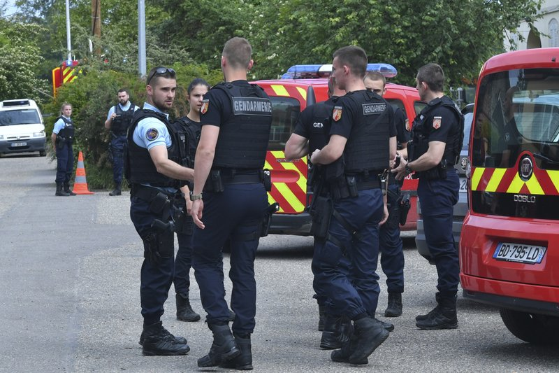 German police officers, left, and French police officers meet near Gerstheim, eastern France, Thursday, May 30, 2019. Police say three people were killed and a child disappeared after a small boat capsized in the Rhine River between Germany and France. (AP Photo)