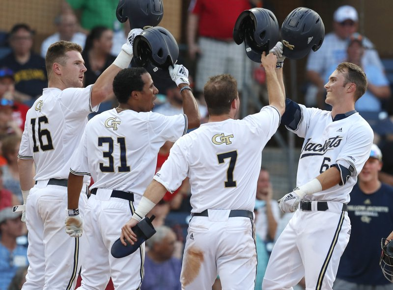 Georgia Tech's Michael Guldberg, right, celebrates with Kyle McCann (16), Nick Wilhite (31) and Luke Waddell (7) after hitting a three-run home run in the fifth inning against North Carolina State in an NCAA college baseball game in the semifinals of the Atlantic Coast Conference tournament in Durham, N.C., Saturday, May 25, 2019. (Ethan Hyman/The News & Observer via AP)