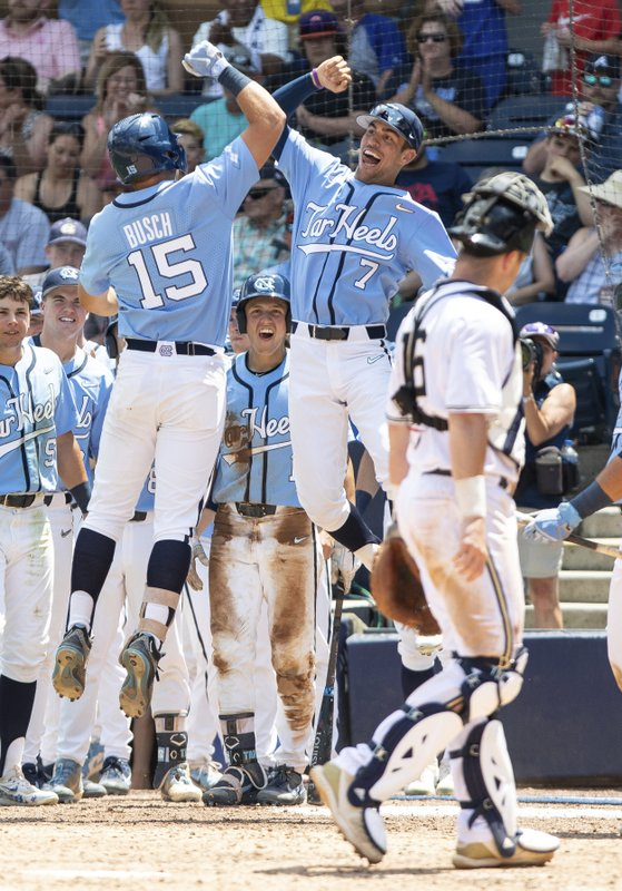 North Carolina's Michael Busch (15) and Dallas Tessar (7) celebrate Busch's home run in front of Georgia Tech's Kyle McCann (16) during the NCAA ACC college baseball championship game in Durham, N.C., Sunday, May 26, 2019. (AP Photo/Ben McKeown)