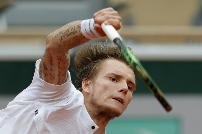 Kazakhstan's Alexander Bublik serves against Austria's Dominic Thiem during their second round match of the French Open tennis tournament at the Roland Garros stadium in Paris, Thursday, May 30, 2019. (AP Photo/Pavel Golovkin)
