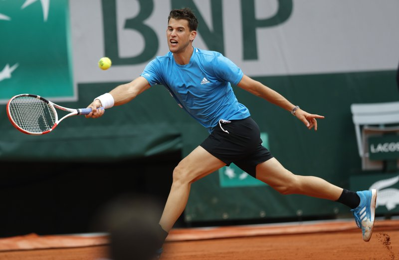 Austria's Dominic Thiem plays a shot against Kazakhstan's Alexander Bublik during their second round match of the French Open tennis tournament at the Roland Garros stadium in Paris, Thursday, May 30, 2019. (AP Photo/Pavel Golovkin)
