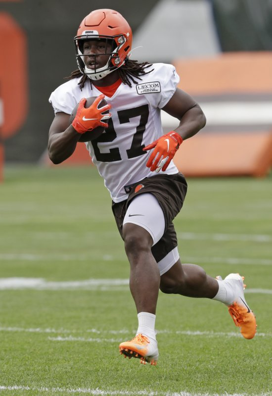 Cleveland Browns running back Kareem Hunt runs a route during an NFL football organized team activity session at the team's training facility, Thursday, May 30, 2019, in Berea, Ohio. (AP Photo/Tony Dejak)