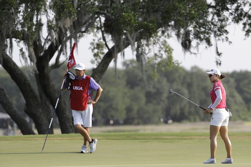 Minjee Lee of Australia, watches her putt on the 10th green during the first round of the U.S. Women's Open golf tournament, Thursday, May 30, 2019, in Charleston. (AP Photo/Steve Helber)