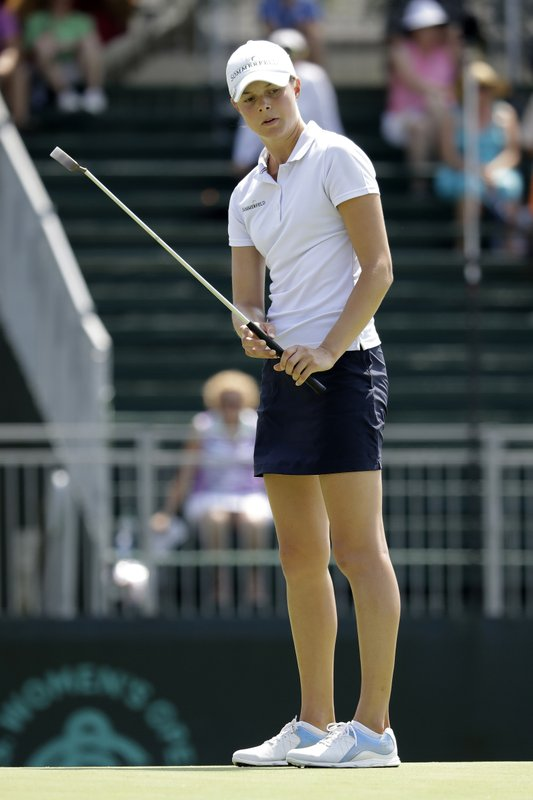 Esther Henseleit of Germany, reacts to missing a birdie on the 18th green during the first round of the U.S. Women's Open golf tournament, Thursday, May 30, 2019, in Charleston, S.C. (AP Photo/Steve Helber)