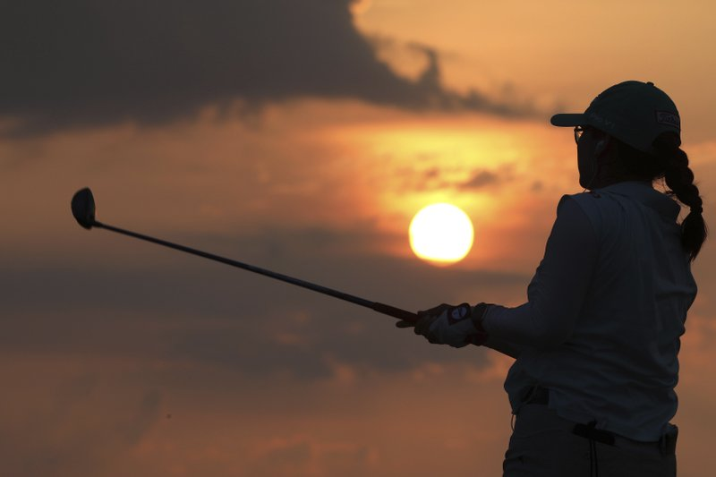 Jimin Kang watches a drive on the range ahead of the first round of the U.S. Women's Open golf tournament, Thursday, May 30, 2019, in Charleston. (AP Photo/Mic Smith)