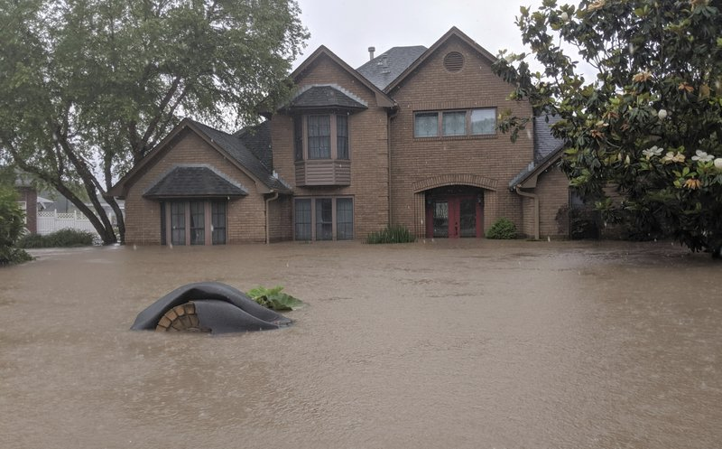 Flood waters surround homes in Fort Smith, Ark., Wednesday, May 29, 2019. Flood waters from the Arkansas River continue to rise. (AP Photo/Hannah Grabenstein)