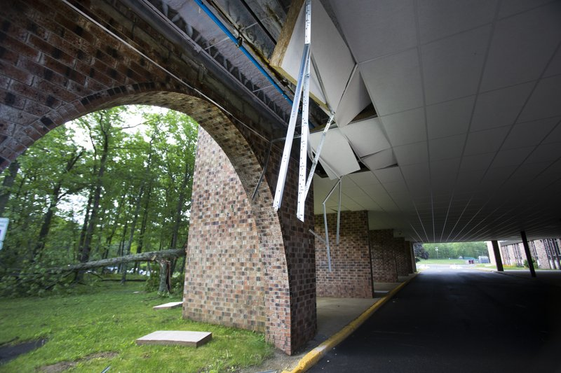 The facade is damaged near the entrance of Lenape Valley Regional High School in Stanhope, N.J. on Wednesday, May 29, 2019.  Lenape Valley Regional High School is closed Wednesday after a storm damaged its facade and ripped up a dugout from its baseball field Tuesday evening. The town also experienced fallen tree branches and downed power lines.  (Michael Mancuso/NJ Advance Media via AP)