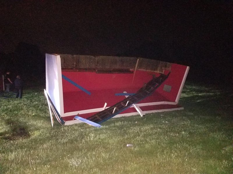 A softball dugout is flipped over from severe weather at Lenape Valley Regional High School in Stanhope, N.J. on Tuesday, May 28, 2019.  Lenape Valley Regional High School is closed Wednesday after a storm damaged its facade.  The town also experienced fallen tree branches and downed power lines.  (Jessica Mazzola/NJ Advance Media via AP)
