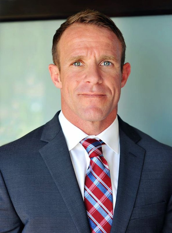 FILE - This 2018 file photo provided by Andrea Gallagher shows her husband, Navy SEAL Edward Gallagher, who has been charged with murder in the 2017 death of an Iraqi war prisoner. Lawyers for Gallagher are seeking to have the charges dismissed for alleged prosecutorial misconduct. Attorneys for Special Operations Chief Gallagher are scheduled to argue in military court Wednesday, May 29, 2019, that the case against him has been tainted by lies, withholding evidence and conducting surveillance on the defense. (Andrea Gallagher via AP, File)