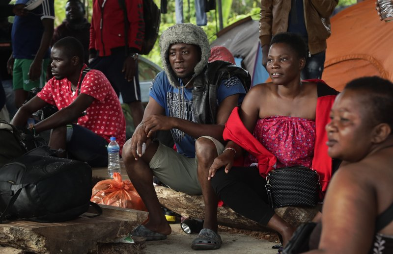 In this May 25, 2019 photo, a group of migrants from Cameroon rest in Bajo Chiquito, Darien province, Panama. Simply closing the border with Colombia would be