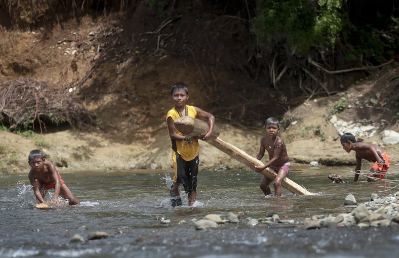 In this May 25, 2019 photo, indigenous children play on the Tuquesa river, Darien province, Panama. A handful of indigenous villages dot the riverbank, and the sound of birdsong is near constant.(AP Photo/Arnulfo Franco)