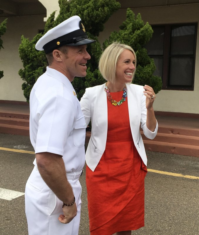Navy Special Operations Chief Edward Gallagher stands with his wife, Andrea Gallagher, after leaving a military courtroom on Naval Base San Diego, Thursday, May 30, 2019, in San Diego. The decorated Navy SEAL facing a murder trial in the death of an Islamic State prisoner was freed Thursday from custody after a military judge cited interference by prosecutors. (AP Photo/ Julie Watson)