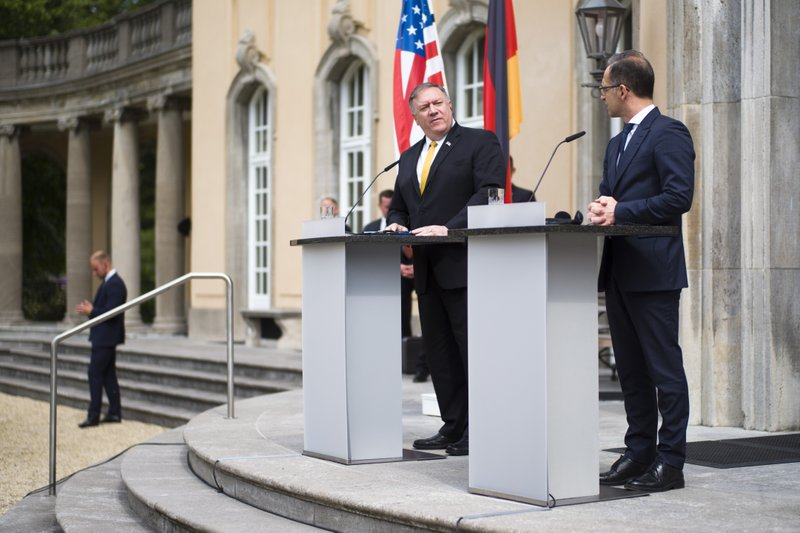 United States Secretary of State Mike Pompeo, center, and German Foreign Minister Heiko Maas, right, brief the media after a meeting at the foreign ministry's guest house Villa Borsig in Berlin, Germany, Friday, May 31, 2019. Mike Pompeo is making his first visit to Germany as secretary of state at the start of a four-nation European trip as tensions rise between the U.S. and Iran. (AP Photo/Markus Schreiber)