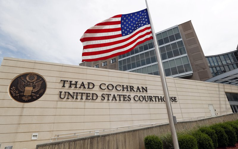 An American flag flies at half-staff for former Mississippi U.S. Sen. Thad Cochran, outside the Thad Cochran United States Courthouse, named in his honor last year, in downtown Jackson, Miss., Thursday, May 30, 2019. Cochran died early Thursday morning, in Oxford, according to his former congressional office. He was 81. (AP Photo/Rogelio V. Solis, File)