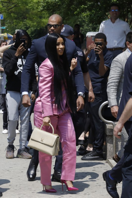 Cardi B arrives at Queens Criminal Court, Friday, May 31, 2019, in New York. Police say Cardi B, whose real name is Belcalis Almanzar, and her entourage were at a nightclub last fall when she argued with a bartender. They say a fight broke out in which chairs, bottles and hookah pipes were thrown, slightly injuring the woman and another employee. She has been charged with misdemeanor reckless endangerment and assault. (AP Photo/Mark Lennihan)