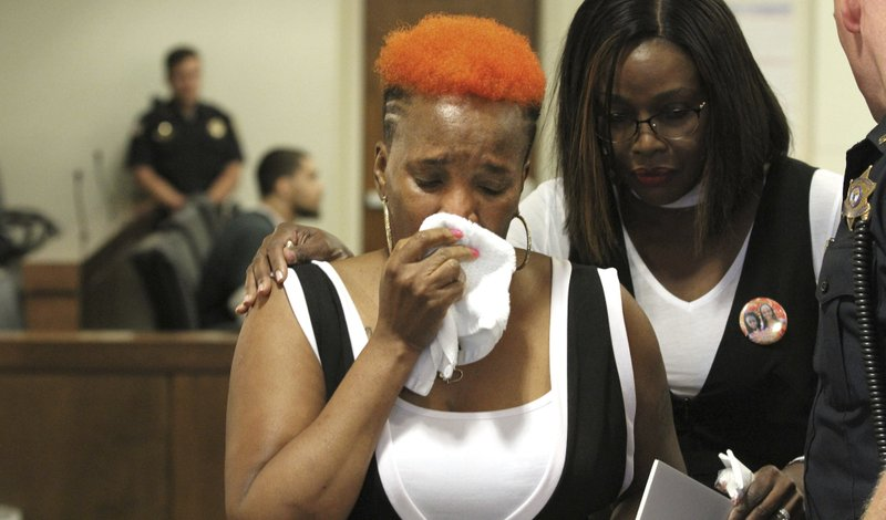 Cecille Bennett Downy, right, consoles her sister Carol Bennett as she wipes tears away after addressing the court during the sentencing for Andreas Erazo, who pled guilty to murdering her daughter Abbiegail Smith. Erazo was sentenced Friday, May 31, 2019, to a life prison term for the murder of the 11-year-old girl in Keansburg. (Thomas P Costello/The Asbury Park Press via AP, Pool)