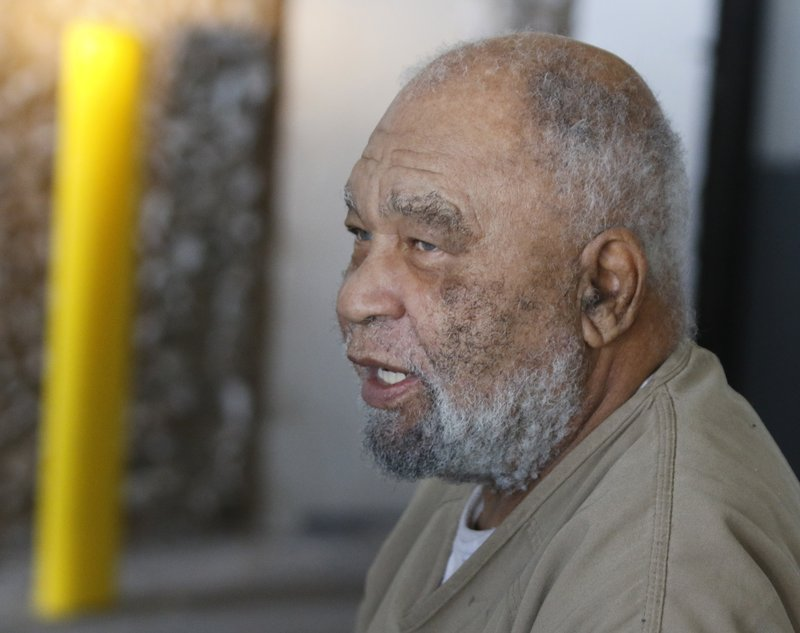 FILE - In this Monday, Nov. 26, 2018 file photo, Samuel Little, who often went by the name Samuel McDowell, leaves the Ector County Courthouse after attending a pre-trial hearing in Odessa, Texas. Little, who has confessed to killing more than 90 women across the U.S. has been indicted in Cleveland for the strangulation deaths of two women decades ago. Cuyahoga County Prosecutor Michael O'Malley on Friday, May 31, 2019 said 78-year-old Samuel Little confessed to killing 21-year-old Mary Jo Peyton in 1984 and 32-year-old Rose Evans in 1991.(Mark Rogers/Odessa American via AP, File)