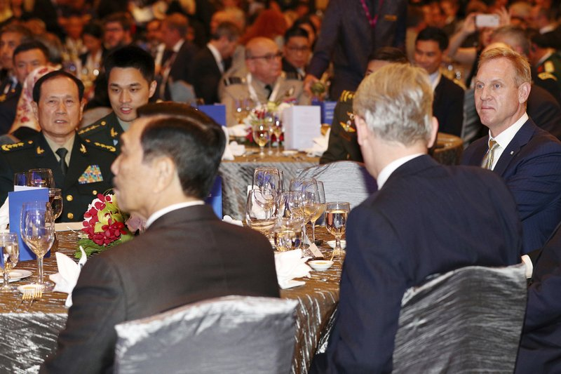 Acting U.S. Secretary of Defense Patrick Shanahan, right, and Chinese Minister of National Defense Wei Fenghe, left, attends the opening dinner of the 18th International Institute for Strategic Studies (IISS) Shangri-la Dialogue, an annual defense and security forum in Asia, in Singapore, Friday, May 31, 2019. (AP Photo/Yong Teck Lim)