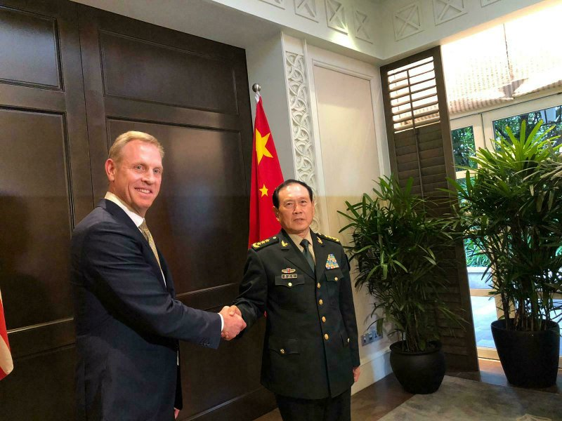 Acting U.S. Secretary of Defense Patrick Shanahan, left, shakes hands with Chinese Minister of National Defense Wei Fenghe during a meeting on the sidelines of the 18th International Institute for Strategic Studies (IISS) Shangri-la Dialogue, an annual defense and security forum in Asia, in Singapore, Friday, May 31, 2019. (AP Photo/Lolita Baldor)