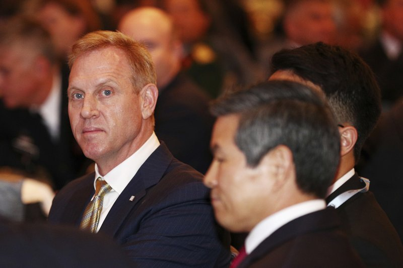 Acting U.S. Secretary of Defense Patrick Shanahan, left, attends the opening dinner of the 18th International Institute for Strategic Studies (IISS) Shangri-la Dialogue, an annual defense and security forum in Asia, in Singapore, Friday, May 31, 2019. (AP Photo/Yong Teck Lim)