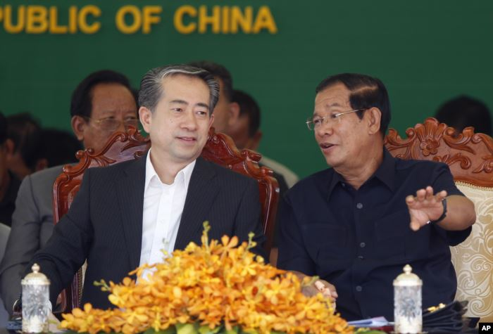 Cambodian Prime Minister Hun Sen, right, talks with Chinese Ambassador to Cam