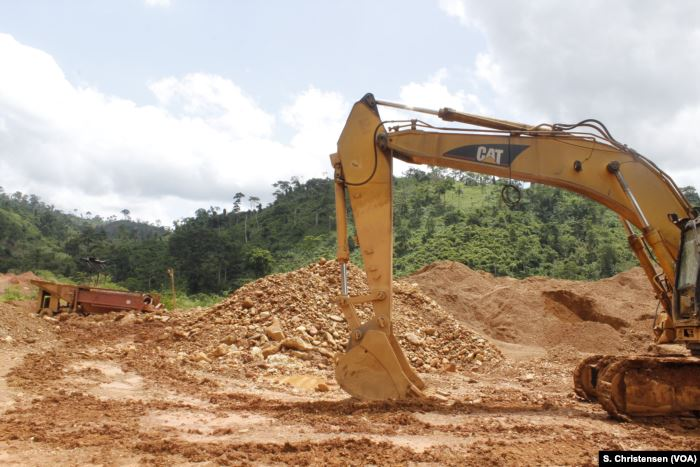 Excavators lie still at a small-scale gold mining site at the foot of the Ate