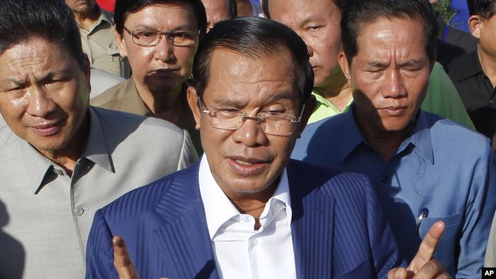FILE - Cambodian Prime Minister Hun Sen gestures while speaking in Phnom Penh