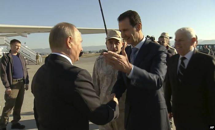 FILE - In a frame grab made available by Russian Presidential TV, Syrian Pres