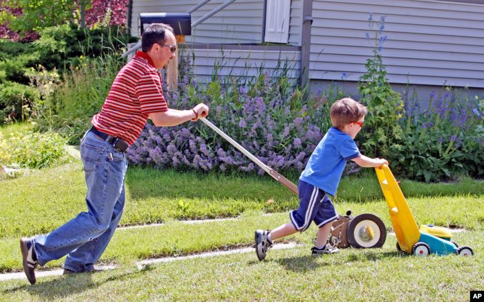 FILE -- Many American children learn about lawn care early on. Photo taken in