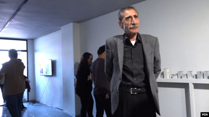 Mikail Kirbayir attends the opening of an art exhibition in Istanbul honoring