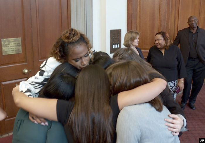 This image taken from video shows singer Jennifer Hudson embracing student jo