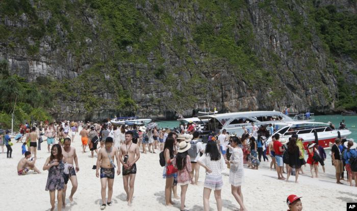 Tourists enjoy the beach at Maya Bay, Phi Phi leh island in Krabi province, T