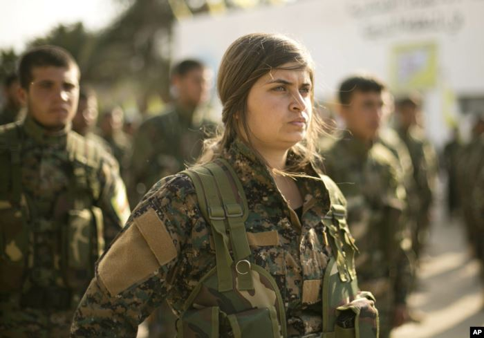 U.S.-backed Syrian Democratic Forces (SDF) stand in formation at a ceremony t