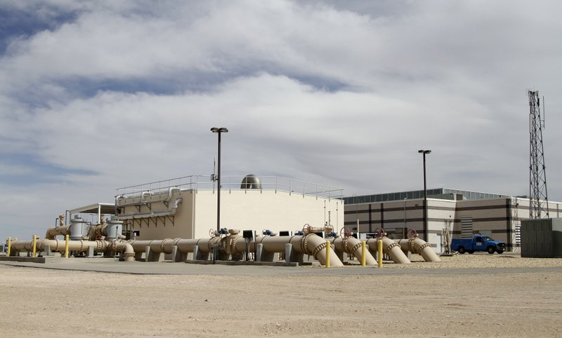 In this May 2, 2019 photo, a desalination plant stands in El Paso, Texas. Texas officials are struggling to ensure that they can sate everyone's thirst as about 1,000 people arrive each day in a state where prolonged drought is a regular occurrence. Indications that the state's water infrastructure is more fragile than once thought come as demographers expect the population to double by 2050 to more than 50 million. Officials are focusing more on long-term planning, but they must contend with aging water lines and other roadblocks. (AP Photo/Cedar Attanasio)