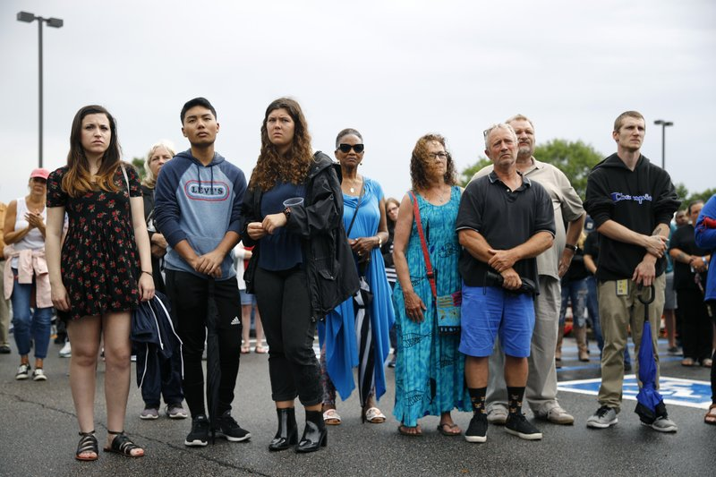 People gather for a vigil in response to a fatal shooting at a municipal building in Virginia Beach, Va., Saturday, June 1, 2019. A longtime city employee opened fire at the building Friday before police shot and killed him, authorities said. (AP Photo/Patrick Semansky)