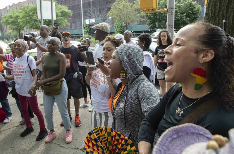 Activists and people who have been affected by gun violence sing together at the end of a march and rally to call for the end of gun violence on the streets of New York City, Saturday, June 1, 2019, in Harlem. The National Action Network joined other activists Saturday for a march in Harlem to call for peace and unity. (AP Photo/Mary Altaffer)