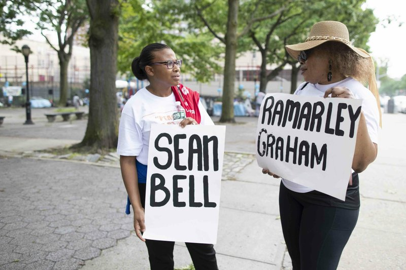 Activists hold signs inscribed with the names of men who were killed by New York City police officers during a march and rally to call for the end of gun violence on the streets of New York City, Saturday, June 1, 2019, in Harlem. The National Action Network joined other activists Saturday for a march in Harlem to call for peace and unity. (AP Photo/Mary Altaffer)