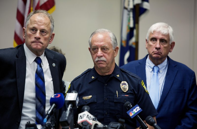 Virginia Beach City Manager Dave Hansen, left, Virginia Beach Chief of Police James Cervera, center, and Mayor Bobby Dyer listen during a news conference Saturday, June 1, 2019 in Virginia Beach, Va. DeWayne Craddock, a longtime city employee, opened fire at the municipal building Friday before police shot and killed him, authorities said. (Bill Tiernan/The Virginian-Pilot via AP)