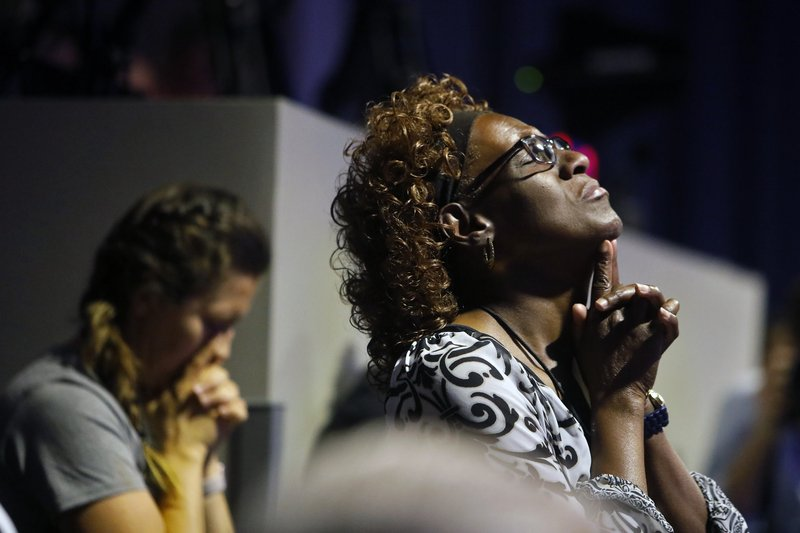 Sandra Deadwyler is overcome with emotion while praying during a vigil for the victims of the mass shooting at the Bridge Church,  Saturday, June 1, 2019 in Virginia Beach, Va. DeWayne Craddock, a longtime city employee, opened fire at the municipal building Friday before police shot and killed him, authorities said. (Jonathon Gruenke/The Virginian-Pilot via AP)