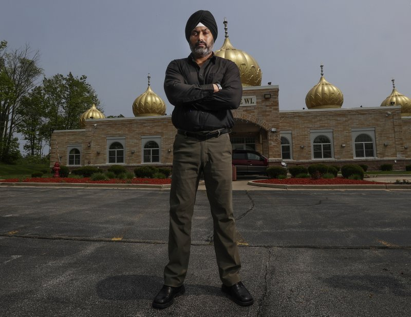 """In this Saturday, June 1, 2019 photo, Pardeep Singh Kaleka poses for a portrait outside the Sikh Temple in Oak Creek, Wis. Kaleka, whose father was one of six people killed in a 2012 mass shooting at a Sikh temple in Wisconsin, has bonded with those who've lost families in other attacks. He's traveled to Pittsburgh, Newtown, Conn. and Charleston, S.C., and says there's another instant connection with survivors from those communities. """"We're like family,"""" he says. (AP Photo/Morry Gash)"""