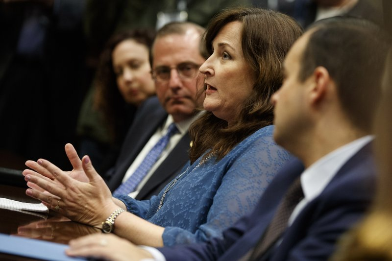 FILE - In this Thursday, Feb. 22, 2018 file photo, Parkland, Fla., Mayor Christine Hunschofsky speaks during a meeting with President Donald Trump and state and local officials on school safety, in the Roosevelt Room of the White House in Washington, D.C.. The mayor and others who've experienced mass shootings in their communities have bonded, comforting and offering advice to one another. (AP Photo/Evan Vucci)