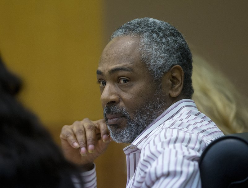 "FILE- In this Aug. 24, 2016 file photo, Martin Blackwell watches arguments during his trial in Atlanta. Blackwell, who was convicted of throwing scalding water on a sleeping same-sex couple, told one of them to ""get out of my house with all that gay,"" a victim testified, but he couldn't be charged with a hate crime because the state has no such law.  Georgia is one of only four states - along with South Carolina, Wyoming and Arkansas - without an official hate crimes law.   (AP Photo/John Bazemore, File)"