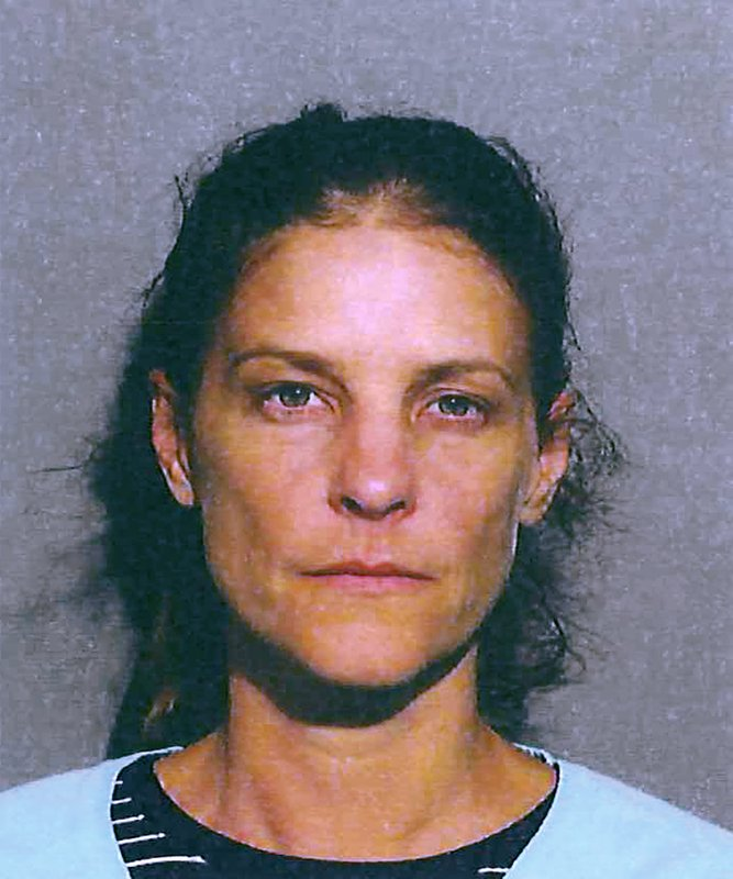This photo provided by the New Canaan Police Department shows Michelle C. Troconis. Police in Connecticut have arrested a missing mother of five's estranged husband and his girlfriend on charges of evidence tampering and hindering prosecution. New Canaan authorities announced Sunday, June 2, 2019, the arrests of 51-year-old Fotis Dulos and 44-year-old Troconis. Both were detained on $500,000 bail and are scheduled to be arraigned Monday in Norwalk Superior Court. Details of the allegations were not released. (New Canaan Police Department via AP)