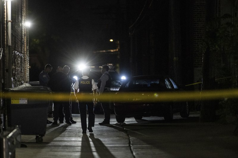 Chicago police investigate the scene where multiple people were shot, Saturday night, June 1, 2019, in the Austin neighborhood of Chicago. Chicago police say dozens of people were shot, several of them fatally, in gun violence over the weekend. (Tyler LaRiviere/Chicago Sun-Times via AP)