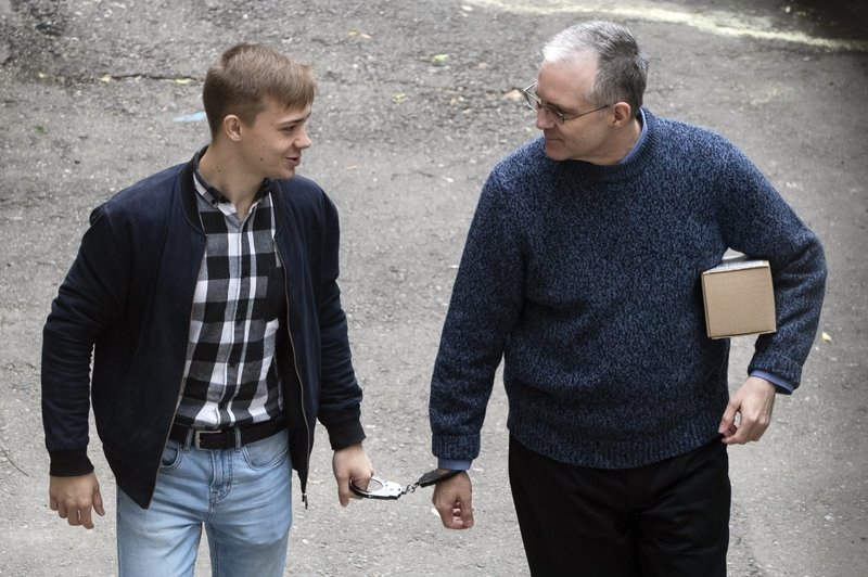 Paul Whelan, a former U.S. Marine, right, who was arrested in Moscow at the end of last year, is escorted for a hearing in a court in Moscow, Russia, Friday, May 24, 2019. The American was detained at the end of December for alleged spying. (AP Photo/Pavel Golovkin)