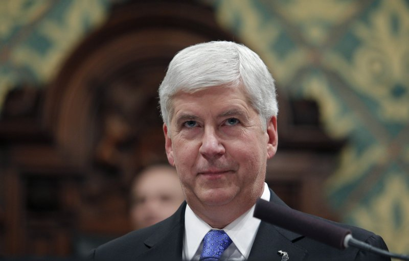 FILE - In this Tuesday, Jan. 23, 2018, file photo, Michigan Gov. Rick Snyder delivers his State of the State address to a joint session of the House and Senate at the state Capitol in Lansing, Mich. Authorities investigating Flint's water crisis have seized from storage the state-owned mobile devices of Snyder and 65 other current or former officials. Documents obtained through a public records request show search warrants were sought two weeks ago by the attorney general's office and signed by a Flint judge. (AP Photo/Al Goldis, File)