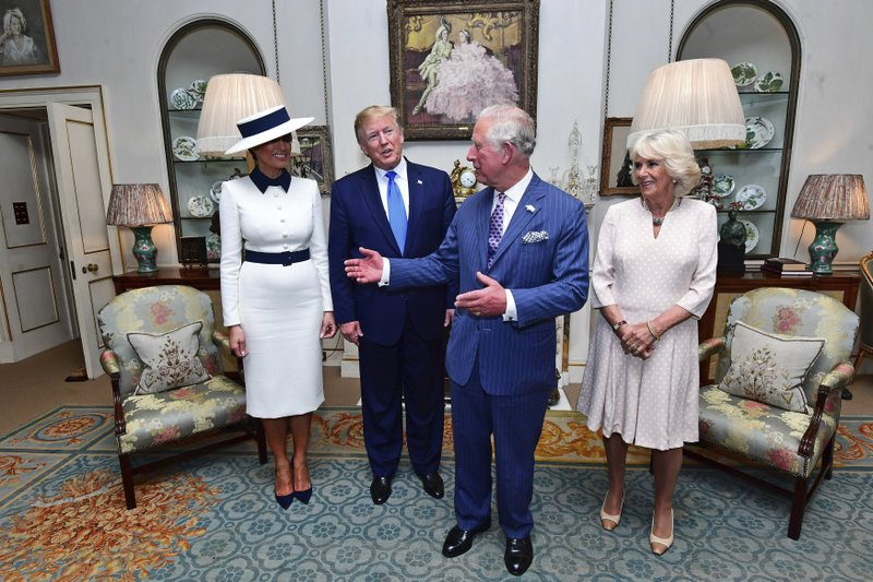 US President Donald Trump, centre left and his wife, first lady Melania, left, listen to Britain's Prince Charles and Camilla, the Duchess of Cornwall prior to afternoon tea at Clarence House, in London, Monday, June 3, 2019. Trump is on a three-day state visit to Britain. (Victoria Jones/Pool Photo via AP)
