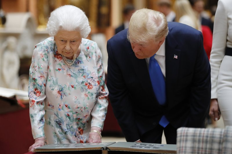 Britain's Queen Elizabeth speaks to U.S President Donald Trump as they view U.S memorabilia from the Royal Collection, at Buckingham Palace, London, Monday, June 3, 2019. Trump is on a three-day state visit to Britain. (Tolga Akmen/Pool Photo via AP)