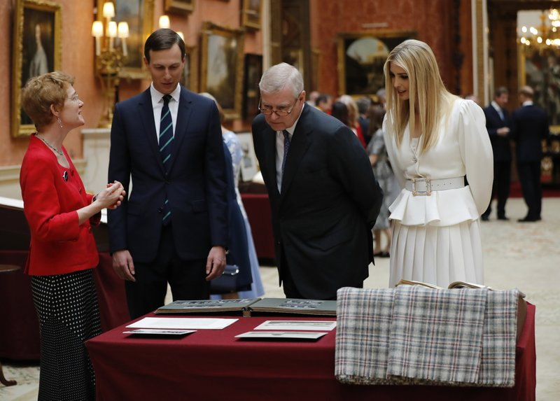 Britain's Prince Andrew, center, talks with Ivanka Trump and her husband Senior Advisor to the President of the United States Jared Kushner as they view U.S memorabilia from the Royal Collection, at Buckingham Palace, London, Monday, June 3, 2019. Trump is on a three-day state visit to Britain. (Tolga Akmen/Pool Photo via AP)